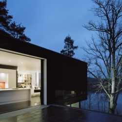 Swedish firm Widjedal-Racki-Bergerhoff create this black and white villa on a sloped plot near Stockholm.