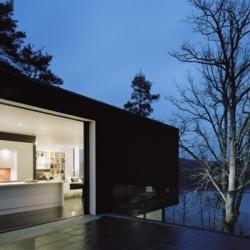 Swedish firm Widjedal-Racki-Bergerhoff create this black and white villa on a sloped plot near Stockholm.