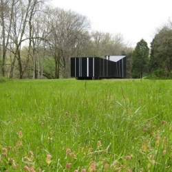 Pinstripe - The American architecture firm Studio Building designed this black and white striped house in Wayne County - Tennessee. The striping matches the silhouettes of neighboring trees.