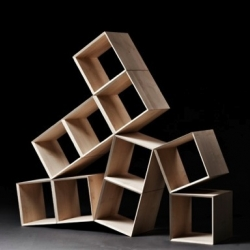 Io is a modular storage system by danish designer Jakob Jørgensen. Various square modules are assembled and appear unbalanced.
