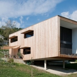 Masserey House is a family house made of wood and concrete by Actes Collectifs Architects in Venthone - Switzerland