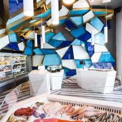 Canadian designer Jean de Lessard has reinvented a walk on the bottom of the sea in this striking fishmonger in Montréal.