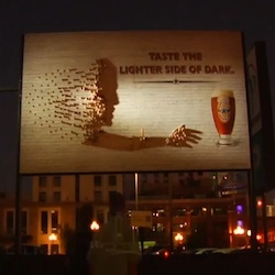 800lb Artists collaborated with Newcastle beer to build a one of a kind billboard using shadows.  At night, the object reveals an image of a man reaching for a beer.