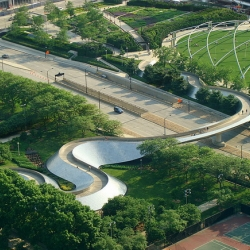 The BP Pedestrian Bridge, a girder footbridge in the Loop community area of Chicago, Illinois. This pedestrian bridge serves as a noise barrier for traffic and connects Millennium Park to parts of Grant Park.