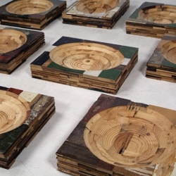 Dutch designer Piet Hein Eek created these small containers milled from scrap wooden slices.