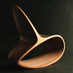 Ocean Rocker III by British designer Jolyon Yates. A birch laminate sculptural rocking chair.
