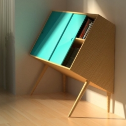 Chin up by british designer Lisa Sandall. A small wooden storage to put along a wall. Between balance and imbalance.