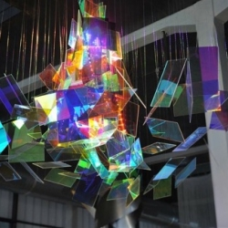 "With their ""Diffractions"", french artists Etienne Rey and Laurent Le Bourhis from Voss Studio play with glass, lights, reflects and spaces. Poetic and colorful."