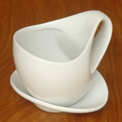The Ultimate Coffee Cup by Lux-Delux Design. The ultimate in ergonomic modern design. A unique and innovative cup that is as delightful to the hand as it is to the eye.
