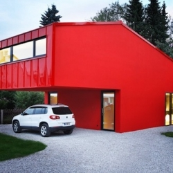 "In Unterföhring - Germany, Jakob Bader has designed this ""House V"", a concrete and steel cladded house. Red and contemporary."