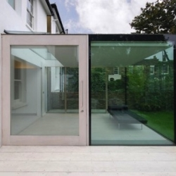 Albion House in Islington by London architects Studio Octopi. A house extension with a minimal glass box opening into the garden.