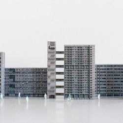 A collection of paper cut-out models representing brutalist architecture of London from 1960s-1970s.