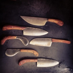 Hand-crafted knives made of old carbon steel files by Chelsea Miller Knives.