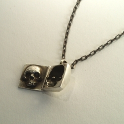 Gorgeous solid silver skull locket by This Charming Man.