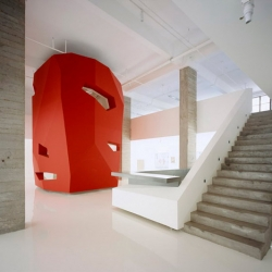 'A Red Object' by 3Gatti Architecture  Studio is located in a Shanghai office within a former factory.