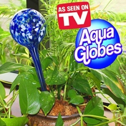 HAND BLOWN AQUA GLOBE continuously water's plants up to two weeks without a refill.