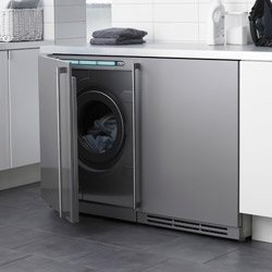 "ASKO Creative Laundry - a new designer range of modular integrated laundry products that are made for ""designers and architects"" ~ hidden behind cabinets are washers, dryers, drying closests, and more..."
