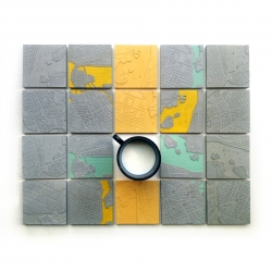 The Concrete Cities by the Greek design duet A Future Perfect project is a series of concrete coasters with the map relief of favorite cities of the world on their surface.