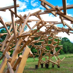 The Species Niches Pavilion commissioned for the Omi Sculpture Garden in Ghent, NY, formed from 1,000 pieces of small oak.