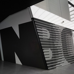 The new Adidas Laces R&D building in Germany is spectacular inside and out. From the 'turbocharged' signage system by Uebele to the lace-like pathways crossing the atrium and striking exterior by Kada Wittfield Architektur.