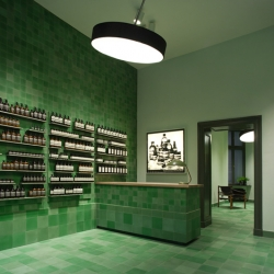 Design studio Weiss-Heiten used emerald-coloured tiles to cover the walls, floors and surfaces of the new Berlin store for skincare brand Aesop (+ slideshow).