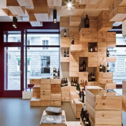 The Albert Reichmuth wine shop in Zurich, Switzerland made from used wine boxes. Designed by OOS Studios.