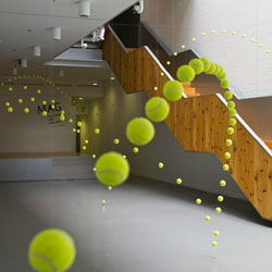 Ana Soler's fun installation Causa-Efecto (Cause and Effect) with 2000 tennis balls hung to look like they're bouncing every which way.