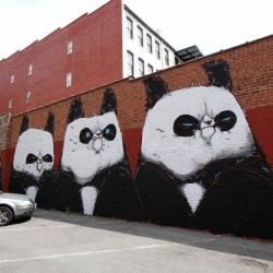 This mural was painted by Angry Woebots in April 2012 as part of G40 by Art Whino.