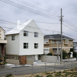 N House by Tokyo Architect Jun Aoki. Located in the small commuter town of  Kohoku, Japan, it neither clashes nor completely blends in with the surrounding scenery.