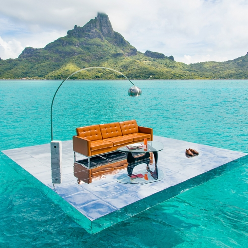 Photographer Gray Malin has created a new series by installing iconic mid-century modern furniture on the top of a 15ft by 15ft mirrored platform constructed in Bora Bora.