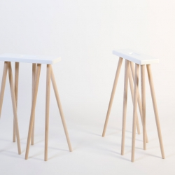 The CATERPILLAR TRESTLE is a table trestle consisting of a bundle of legs that seem to be set in perpetual motion. It can also be used as an informal stool.