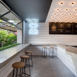 Melbourne-based designer Travis Walton crafts badass burger shop for BO$$ MAN.