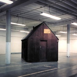 The haunting image of the Unabomber cabin sitting in an FBI storage facility.  Photo by Richard Barnes