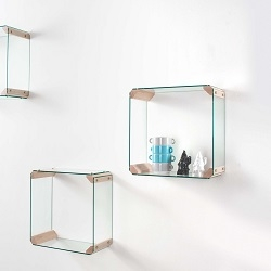 Composed from four glasses 5mm thick and 4 joints in solid wood. The structure is assembled with simple screws holding the glass to wood.  The wall supports are provided in the package.  Dim: cm 42x42x12