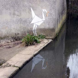 Banksy's latest piece, a stork located on a wall beside a river.