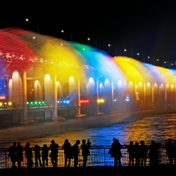 Banpo Bridge Rainbow Fountain in Seoul, South Korea, is the world's longest bridge fountain. The fountain is programmed to play different shows during the day and night.