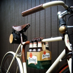 Finally, a six pack holder for your bicycle! Roll up to your summertime BBQ's safely and in style! Designed by Portland based Walnut Studios.