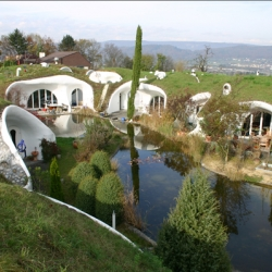 Earth house projects from Erdhaus, swiss architect and team. Looks like a modern version of hobbit holes. I love it.