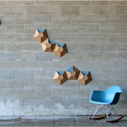 I like this playful yet functional idea from Apersand. Simple geometric shapes inspire these wallpockets. A perfect way to storage and decorate at the same time!