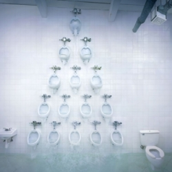 American Standard is an installation that featured fifteen functional urinals arranged in a pyramid formation on the wall of the men's washroom at Simon Fraser University.