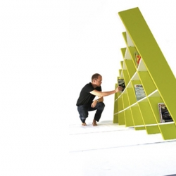 Billy Brother bookshelf by Addi Design. The design is a hybrid between ordinary bookshelf and a sculpture.The shelves are displaced in a wave like motion that creates an interesting expression and a playful meeting between the wall and the floor.