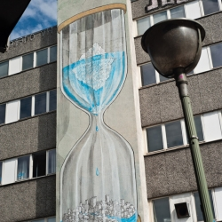 Blu's latest wall in Berlin tackles global warming.