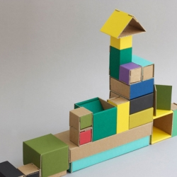 Set of recycled nesting cardboard boxes by ¿Adónde?.  Playful, useful, and perfect for small accessories. The pieces can be used separately or left in the base.
