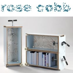 Books to Go by Rose Cobb, is a modular transportable bookcase. I love the little wheels and the handle that doubles as a book end.