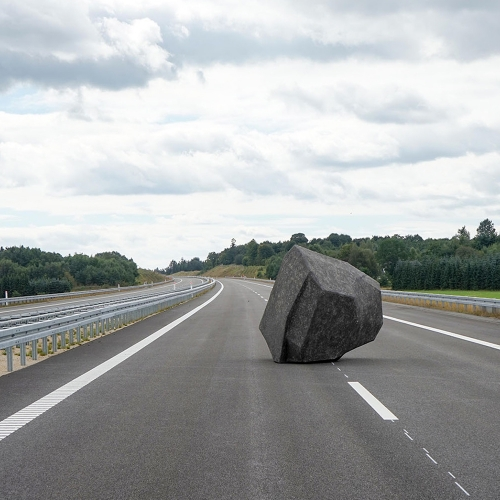WURF III [throw] is the third phase of the Throw-Project by Anna Borgman and Candy Lenk. The large stone imitation is placed on a lane of Silkeborg Motorvej connecting the Danish cities of Herning and Aarhus.