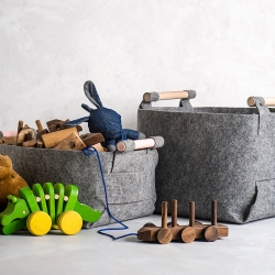 Loop design studios Felt storage bins are made from one piece of felt that can be folded into a sturdy bin with snap closures.