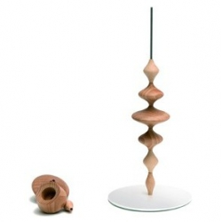 """""""Les Perles"""" is a modular candleholder designed by FX Ballery, on which small pieces of wood can be slipped over a metal rod."""