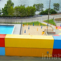 Photos of Brooklyn Bridge Park's colorful new Pop-Up Pool and mini beach that was just opened this morning.