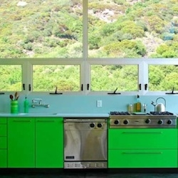In this Los Angeles kitchen designed by Bruce Bolander, acid green cabinets complement a pale blue backsplash.