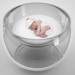 The image of a baby, nestled in a cloud of soap bubbles, inspired children's furniture designer Lana Agiyan to go beyond the traditional interpretation of a crib, and create the Bubble Baby Bed.